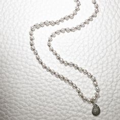 Tiny #pearls knotted on jewelers silk #diamond #charm #style #fashion #jewellery #jewelry #necklace #pin