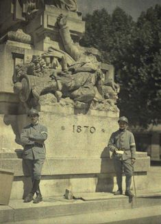 WWI, 1917,Soissons; Soldiers in front of 1870 monument.