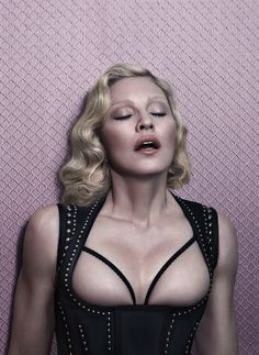 Madonna Poses Topless For Interview Magazine Photos of Madonna posing topless for the Interview Magazine. This obviously isn't the first time Madonna has taken part in a revealing photo shoot but she's proving that even at Sandro, Lgbt, Madona, Alas Marcus Piggott, La Madone, Anderson Cooper, Foto Pose, Everything, Angels On Earth