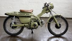 Cream painted Honda CT110 postie bike. Very snazzy.