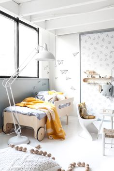 Grey in Kids Room - Petit & Small // sophisticated toddler room with the nicest car bed I've ever seen! Touches of yellow break up the white and pale grey palette.