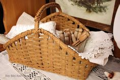 a basket filled with linen and lace makes me so happy.  it just needs a red bow.  thank you, j