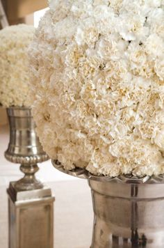 Pomanders of white carnations are displayed on silver pedestals. Wedding Themes, Wedding Photos, Wedding Ideas, Wedding Inspiration, Centerpiece Decorations, Reception Decorations, White Carnation, Reception Design, Winter Wonderland Wedding