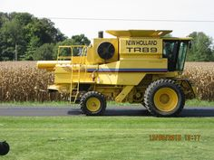 New Holland TR89 passing by Koeing Equipment