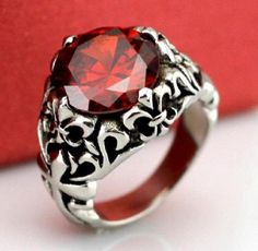 Men's Jewellery Fleur De Lys Red Ring Titanium Steel. High quality ring, with stunning design, this red ring made from heavy metal titanium steel, unique ring for your formal occasion accessories, pair it with a red batik shirt.  http://www.zocko.com/z/JIalF