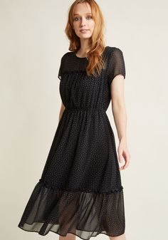 <p>There's no better spokesperson for the charm of clip dots than you, especially in this black midi dress! A sheer neckline, sleeves, and hem trimmed with frills add flounce to this retro-inflected A-line, but it's the textured, soft grey spots that take this look from adorable outfit option to wardrobe must-have.</p>