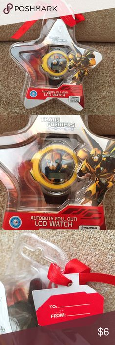 Transformers Prime Bumblebee LCD Digital Watch Brand new in packaging. This Transformers Prime Bumblebee LCD Digital Watch comes in an awesome packaging with a gift tag attached. Demo batteries need to be replaced. Add on to a bundle to save on shipping! Transformers Accessories Watches