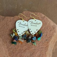 Fender guitar pick earrings with natural stones.