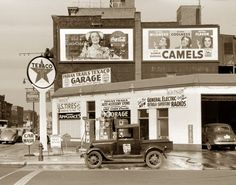 Texaco service station, 1940, with Coca-Cola, Camel cigarettes, G.E. radios and U.S. Tire ads