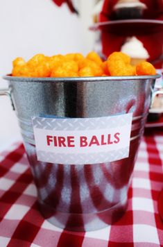 """Serve """"fireballs"""" aka cheese puffs, """"fire truck wheels"""" aka chocolate cookies and """"fire hoses"""" aka red licorice .Evite-Party-Ideas-Fireman-Contributor-Party-Crowning-Details"""