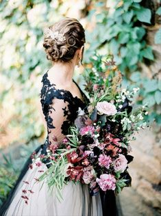 Black lace is an edgy alternative to the trendy illusion sleeve. This chic style is perfect for the trendsetting bride who wants to feel classic with a twist. - gothic + Halloween wedding dress inspiration Halloween Wedding Dresses, Colored Wedding Dresses, Wedding Colors, Wedding Flowers, Dress Wedding, Luxe Wedding, Wedding Tips, Spring Wedding, Wedding Ceremony
