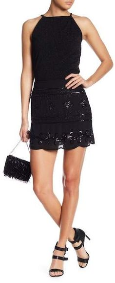 """Endless rose Beaded & Sequins Mini Skirt. Details Tonal beaded and sequins embellishments dazzle this mini skirt with a scalloped hem for simple feminine flair. Fit: this style fits true to size. Hand wash Shell/Lining: 100% polyester Concealed side zip closure Tonal beaded and sequin embellishments Scalloped hem Lined Approx. 16"""" length (size S) Imported"""