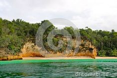 An untapped beach along the shores of Cayo Saetia in Cuba. This location is found at the northeast end of the Caribbean island, just off Nipe Bay. Island Beach, Beach Scenes, Cuba, Caribbean, Tropical, Stock Photos