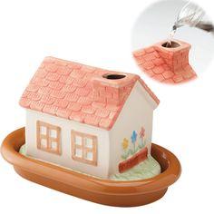 加湿器 かわいい おしゃれ 陶器 エコハウス加湿器 アイデア商品、アイデア雑貨の専門店 「雑貨屋」  煙突から水を入れると、陶器の表面から自然気化するビックリ加湿器。コップ1杯分の水を置いたときの4杯気化する。