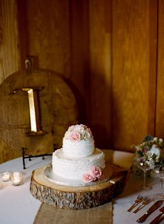Not fond of the cake, but LOVE the wooden stand and burlap runner.