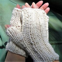 Fingerless gloves are handknit in bulky white 85% merino wool and 15% mohair yarn. These thick white ladies fingerless gloves are knit with ribbing at the wrist and knuckles for a close, warm fit. The ribbing is continued over the top of the hand, while the palm is knit in smooth stockinette stitch. The fabric is very soft, durable and exceptionally warm. The mohair content adds a slight fuzziness, and both merino and mohair lend body, softness and warmth to the fabric. The yarn is bulky…