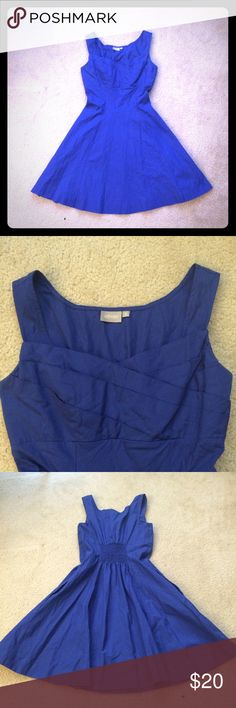 Blue dress with detailed bodice Beautiful blue dress with detailed bodice, side zipper and POCKETS! Great summer dress.  Has straps to keep bra straps in place. 32 inches long, 13.5 inches at waist (with ability to  stretch), 13 at the bust. Dresses