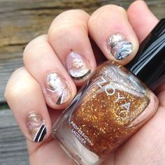 A new take on the water marbling mani with white, black, and gold nail polish for the new year