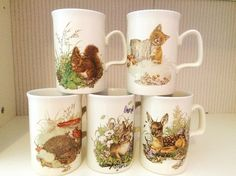 Beautiful set of five vintage woodland animal mugs made by Ashdale of England. Each mug features a woodland animal design with the matching design in a smaller size on the reverse. The set includes a fawn, a rabbit, a hedgehog, a squirrel and a fox. The set is in great vintage condition with no chips or cracks. There is evidence of slight wear to the base of some of the set due to its age, this does not detract from their vintage charm. A lovely set for any lover of woodland animals. All…