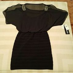 HOLIDAY****BLACK DRESS NWT XSCAPE BLACK DRESS  OPEN SHOULDERS  2 EMBELLISHMENTS ON THE SHOULDER  FITTED ON THE BOTTOM  PERFECT LITTLE BLACK DRESS  SIZE 6 PERFECT CONDITION  MATERIAL 100?POLYESTER  VERY SOFT AND COMFORTABLE  GREAT FOR ANY OCCASION Xscape Dresses Mini