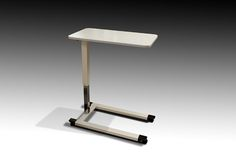 Adjustable height overbed table with solid surface top.