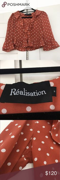 Réalisation Par Cher Top Réalisation Cher Top in Rust Spot. Bought for $155 from their website (incl. shipping) only worn once and dry cleaned. There was some slight marks under arms but I can't even see it after dry cleaning. Silk crepe fabric, fits true to size small. Comes with original bag Reformation Tops