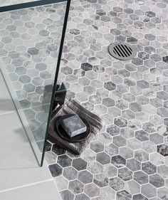 Lantau Grey™ Mosaic Hexagonal Tile Love the hexagon tile and I like the gray variations in this one.  Light grout scares me.