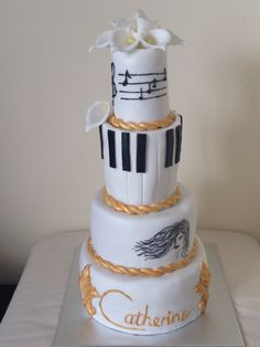 4 tier white black and gold music birthday cake with cala lilies