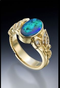 Beautiful opal and diamond ring in 18K gold by Conni Mainne
