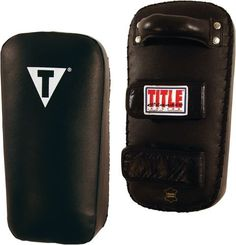 "TITLE Classic Thai Pads - Pair by Title Boxing. $59.99. Excellent, full-bodied kick and punch pads with a Classic TITLE price! Measures a big 16"" long x 8"" wide by a full 4"" thick for a classic ""Take a Pounding"" pad. Rugged all-leather design with riveted handle and two hook-and-loop wrist and arm fasteners. Lace stitch closure keeps overstuffed inner padding secure and firmly intact. Size: 16"" x 8"" x 4"" Weight: Approx. 3 Lbs. Each"