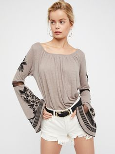 Bonjour Bell Sleeve Tee | Inspired by decades past, this top is featured in a lightweight and semi-sheer linen blend.    * Extreme bell sleeve with mesh and embroidery detailing   * Banded waist   * Wide neckline