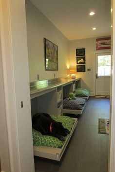 Mud room - counter and dog bed combo. Example of a trendy galley utility room design in Other with flat-panel cabinets, medium tone wood cabinets, stainless steel countertops, gray walls and porcelain floors Animal Room, Utility Room Designs, Utility Room Ideas, Dog Bedroom, Master Bedroom, Puppy Room, Dog Spaces, Stainless Steel Countertops, Niches