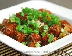 Potato Manchurian Balls Recipe - Deep fried potato cubes rolled in Manchurian sauce and served.