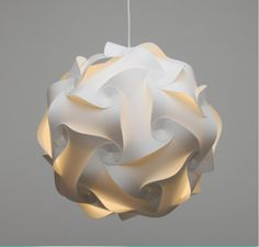 The original design, called an IQ Light, was done over 30 years ago by Holger Strom and what is amazing about this design is you can make up to 22 diferent shapes using the same module pieces.