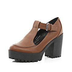 winter must have Tan chunky cleated sole T bar shoes $40.00. boots, heels, brown