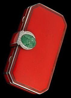 Lady's 18 karat yellow gold and sterling silver enameled vanity case, Tiffany & Co.   1920s   Carved jade and rose cut diamond clasp, inside reveals vanity mirror, double powder and rouge comparments and lipstick, signed by the maker with hallmarking for William C. Moore directorship of Tiffany & Co.