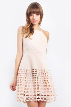 """Gorgeous blush dress with laser cut detail on the hem. Pair it with nude heels and a clutch.- Square neckline- Criss cross back- Adjustable straps- Zipper closure- Partially linedSize + Fit- Model is wearing size S- Measurements taken from size S- Length: 35""""- Chest: 31""""- Waist: 26""""    Material : 95% Rayon 5% Spandex    Care : Hand Wash Only     