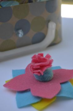 Looking for a fun, easy flower craft for kids? Read on to see how my daughter made this pretty flower! As you know, she is always showing off her creative side by coming up with fun crafts for kids.