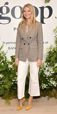 While recording a live episode of the Goop podcast, Gwyneth Paltrow paired white, flared jeans with a plaid Banana Republic blazer and yellow pumps. Black Bustier, Black Strapless Dress, Gwyneth Paltrow, Celebrity Outfits, Celebrity Style, Celebrity Closets, Yellow Pumps, Red Carpet Gowns, Wattpad