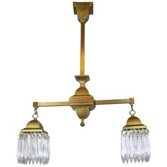 Mission Crystal Fixture circa 1910 Satin Brass Two-Light | From a unique collection of antique and modern chandeliers and pendants at https://www.1stdibs.com/furniture/lighting/chandeliers-pendant-lights/  Matches dining room chandelier