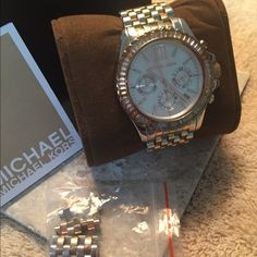 Michael Kors Everest watch, hard to find. Gorgeous Tri-tone (stainless steel, rose and yellow gold tones). Original box, owners manual and extra links included. Battery is working. Michael Kors Jewelry