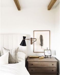 This calm, neutral bedroom decorating in wood and white tones by Nicole Davis gets recreated for less by copycatchic luxe living for less budget home decor.