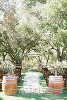 15 Ideas to Steal From These Rustic Wedding Aisles Usher the bride down a rustic wedding aisle with wooden wine barrels decked out in cascading florals or lush garlands. Wedding Ceremony Ideas, Wedding Aisle Decorations, Wedding Aisles, Wedding Bands, Wedding Venues, Altar Decorations, Wedding Backdrops, Wedding Ceremonies, Ceremony Backdrop