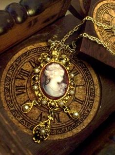 Very victorian cameo pendant.  Gonna try to find one like this for my mom's collection.