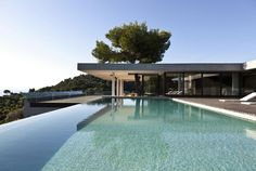 """Plane House is a private residence designed by K Studio. It is located on Skiathos Island, Greece, and was created with the intention of enjoying the outdoors as much as the indoors.                     Plane House by K Studio: """"Summer in the Greek islands is all about being outside. The aim of the Plane House is to merge internal and external space, maximising the benefits of both and minimising the impact on the surrounding landscape. To avoid block volumes that split and dominate space…"""