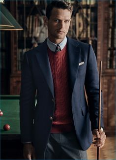 Guy Robinson fronts Dunhill's fall-winter 2016 campaign, donning a sport coat over a cashmere cable knit sweater.