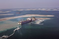 Built using 320 million cubic metres of sand dredged from Dubai's shallow coastal waters a. Shallow, Continents, Making Out, Dubai, Coastal, Around The Worlds, Waves, Boat