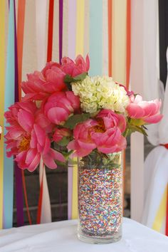 Sprinkles + flowers = classy Use a smaller vase inside to keep water away from sprinkles.