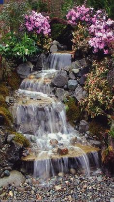 It's not difficult to create a waterfall pond feature rather than the conventional pond. With this small waterfall pond landscaping ideas you will inspired to make your own small waterfall on your home backyard. Garden Waterfall, Small Waterfall, Outdoor Water Features, Water Features In The Garden, Backyard Water Feature, Ponds Backyard, Backyard Waterfalls, Garden Ponds, Backyard Ideas