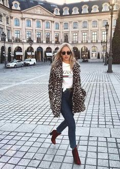 Leopard jacket layered over a gucci tshirt and skinny jeans. See more at www.HerFashionedLife.com